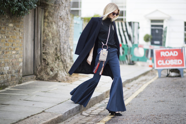 navy and black-turtleneck-black coat-flares-bell bottoms-fringe bags-lfw street style-psuk