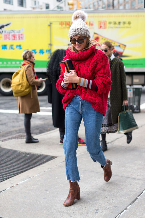 no coat-red oversized sweater-python snakeskin booties-cropped jeans-frayed denim-layers-layering-pom pomp hat-nyfw street style-winter weekend-hbz