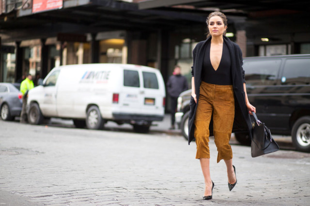 nyfw street style, nyfw fall:winter 2016, new york fashion week, winter to spring dressing, winter outfits, what to wear when it's freezing, layering, layers, brown and black, suede culottes, black coat olivia culpo hbz