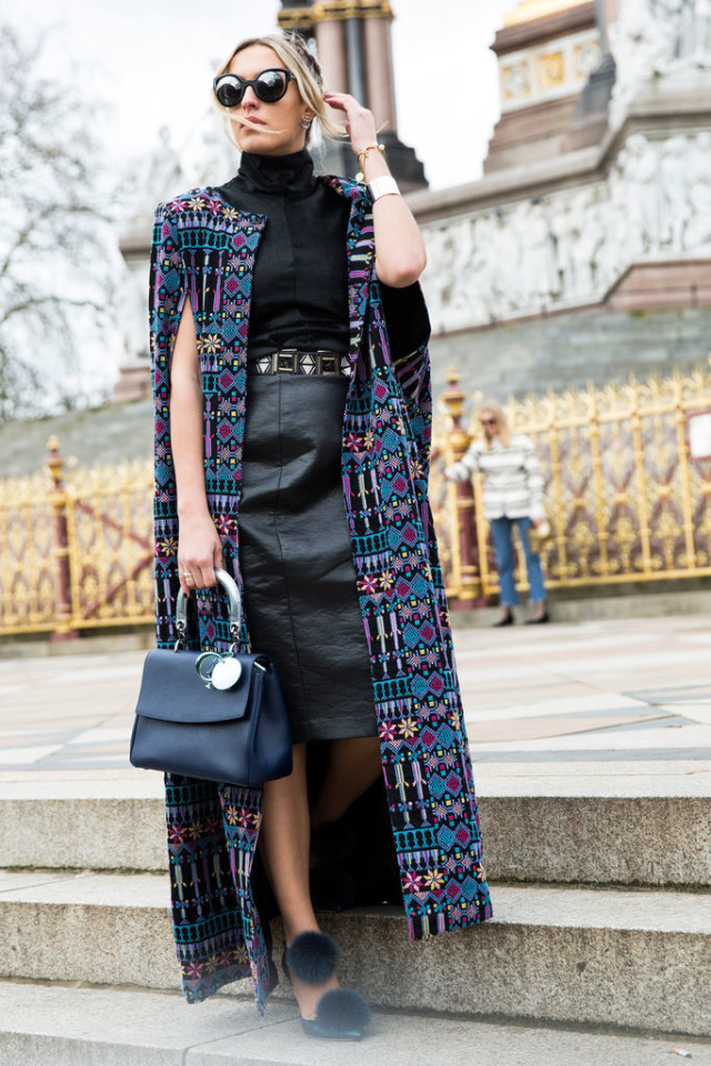 printed cape-all black-turtleneck-black leather skirt-belted-fur shoes-work-lfw street style-psuk