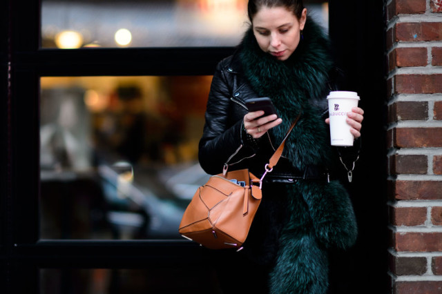 ruthie friedlander-leather moto jacket-colored fur-green fur scarf-crossbody bag-nyfw street style 2016 elle-coffee