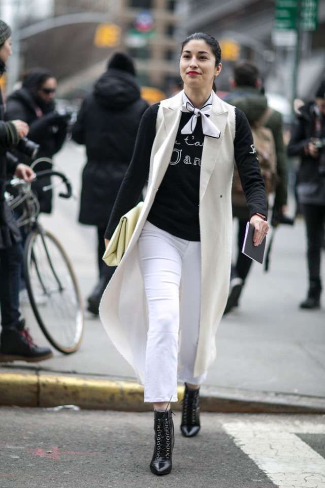 sleeveless jacket-long vest-white jeans-lace up booties-graphic sweatshirt-scarf around neck-caroline issa-work weekend-nyfw street style-ps
