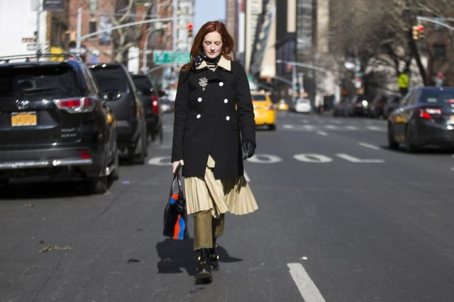 taylor tomassi hil-skirt over pants-olive green pants-black coat-broaoch-strieps-nyfw street style 2016