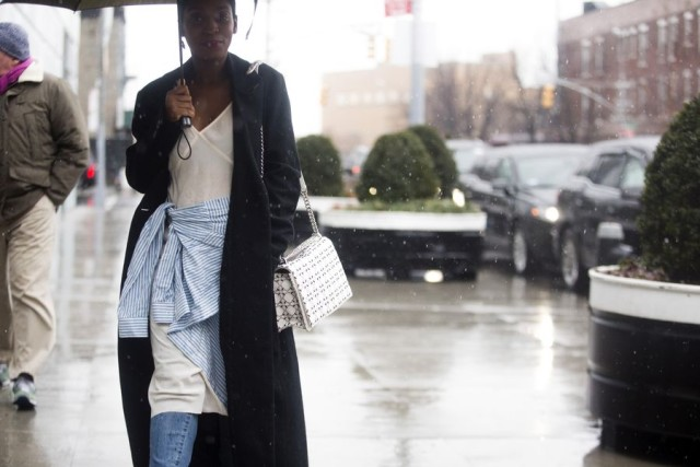 what to wear in the rain-slip dress-dress over pants-shirt tied around waist-black coat-nyfw street style-
