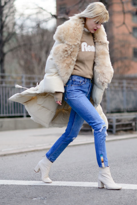 white booties-high waisted mom jeans-graphic sweatshirt-fur trim jacket parka-nyfw street style-