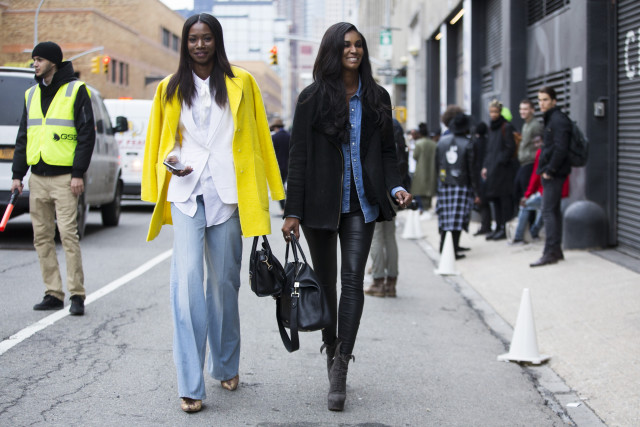 nyfw street style, nyfw fall/winter 2016, new york fashion week, winter to spring dressing, winter outfits, what to wear when it's freezing, layering, layers, model off duty style, yellow, wide leg pants, white blazer, double coats, black leather skinnies, fur coat, layering, Models Sigail Currie and Sessilee Lopez