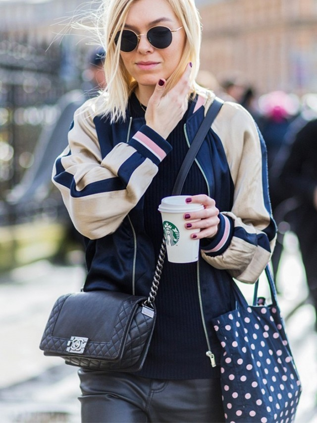 baseball jacket-coffee starbucks-chanel bag-polka dot bag-black and navy-carsity jacket-black leather pants-pfw street style-the styleograph