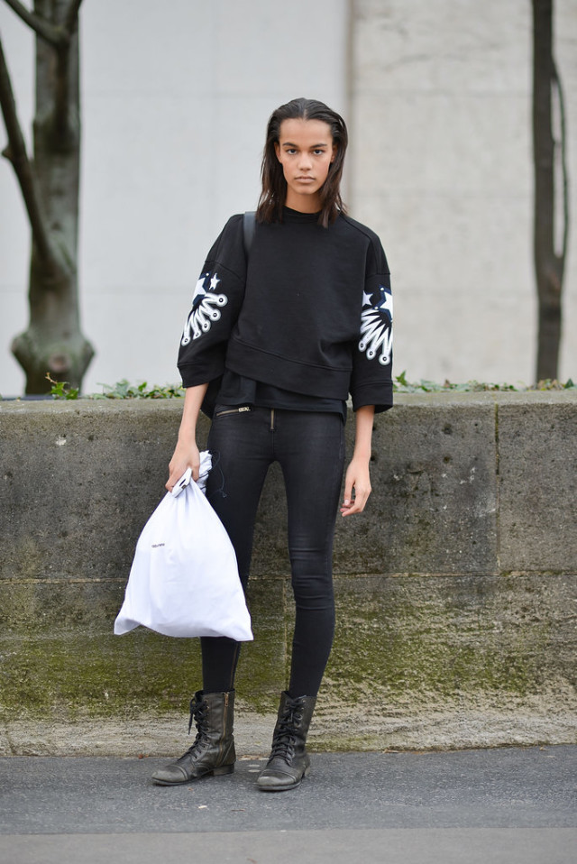 black skinnies-black lace up boots-weekend-graphic sweatshirt-cropped sweatshirt-model off duty style-pfw street style-getty-lace up boots-combat boots