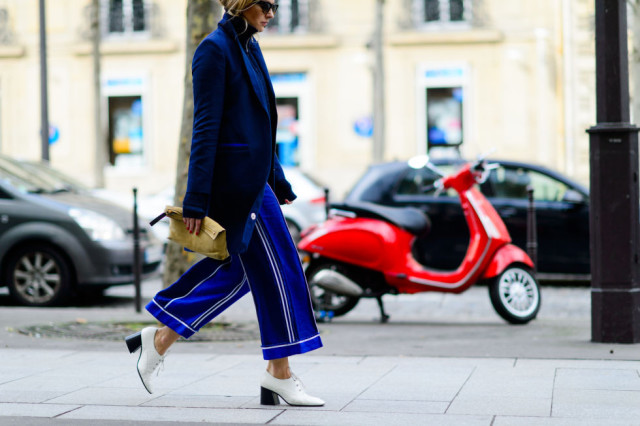 cropped pants and booties-culottes-white shoes-lace up oxfords-navy blazer jacket-pfw street style-elle