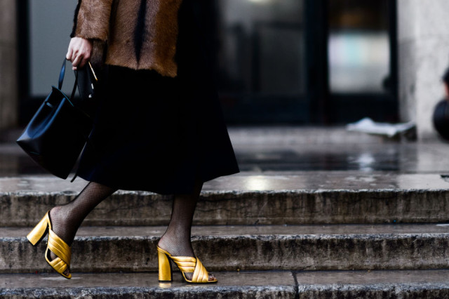 fishnets-fur coat-mules-gold mules-gucci mules-pfw street style-elle