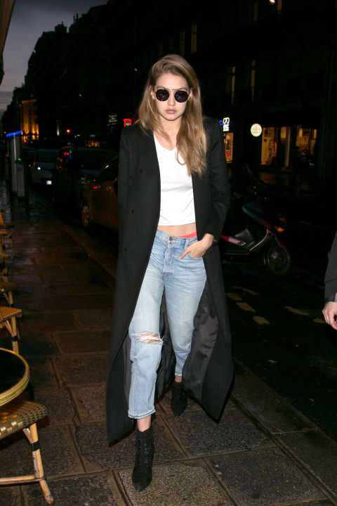 gigi hadid-cropped jeans and booties-crop top-black coat-weekend-pfw street style-