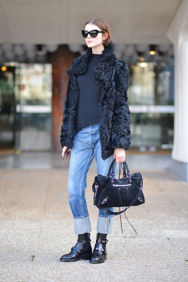 mockneck-cuffed jeans-furry jacket-model off duty style-buckled boots-pfw street style-getty