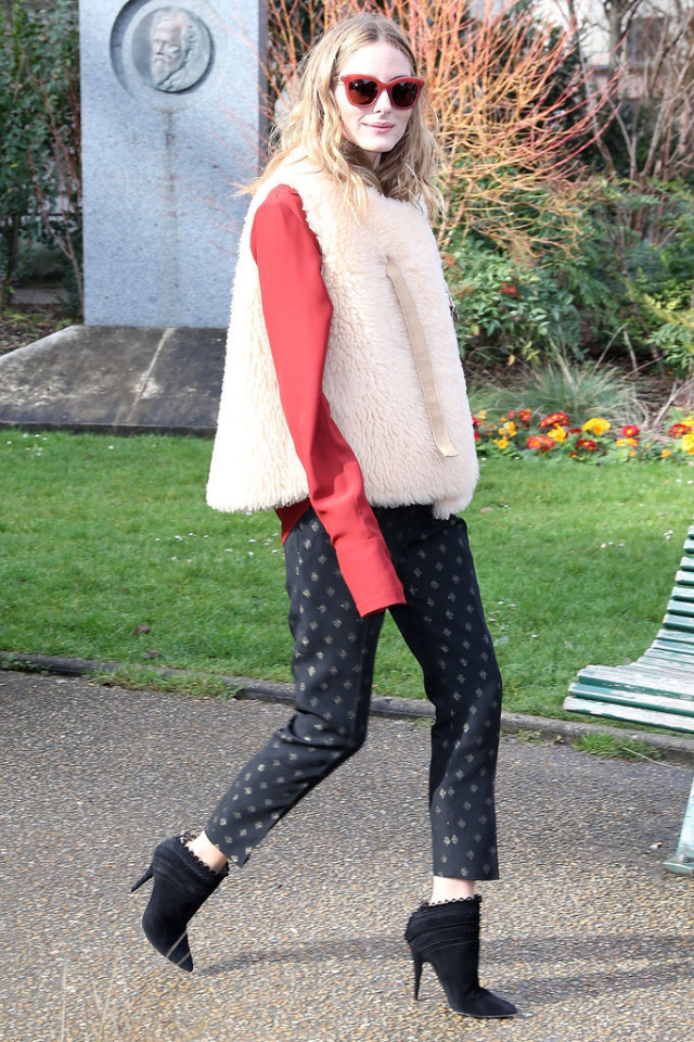 olivia palermo-printed pants-embellished pants-fur vest-shearling fur vest-booties-scalloped-red sunglasses-winter to spring dressing-night out going out-work-office to out-pfw street style