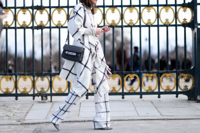 windowpane prints-black and white-printed pants-poncho jacket-pfw street style-elle