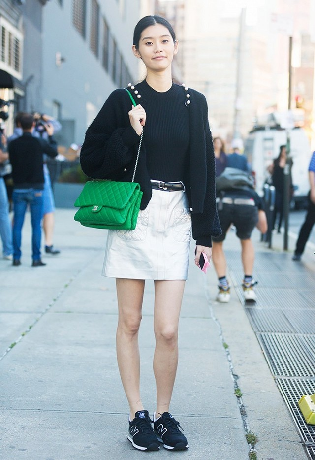 sneakers and skirts-new balance-white mini skirt-green chanel purse-cardigan-black and white-spring work outfit-weekend office to out-party going out-dinner-