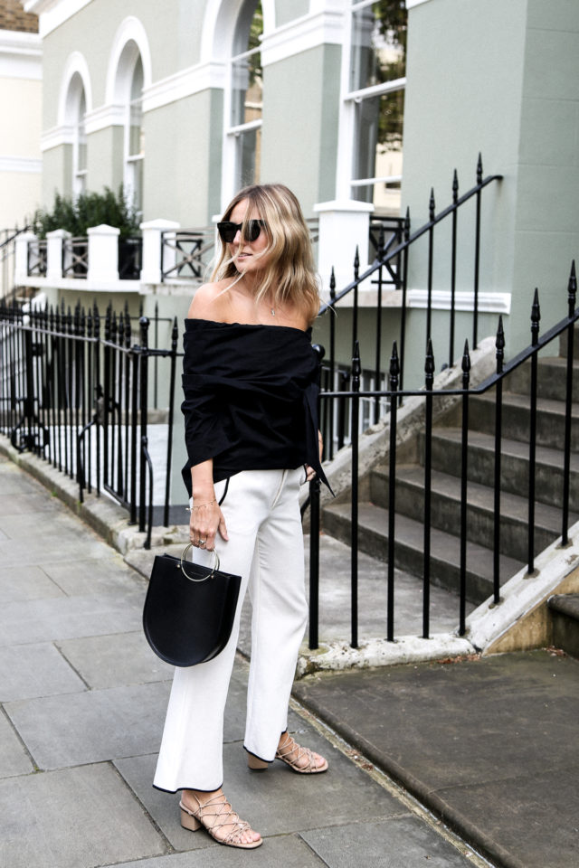 white pants white wide leg pants-cage sandals-black off the going out night out-office to out-shoulder shirt-black and white-