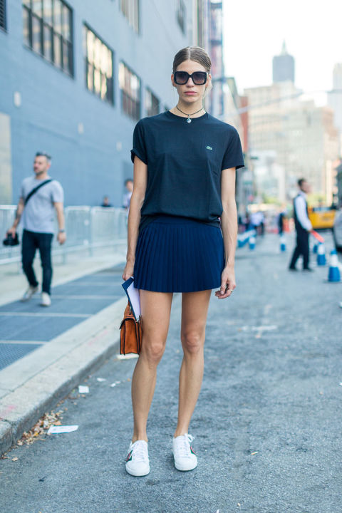 lacoste-tee-white-sneakers-pleated-mini-skirt-navy-choker-nyfw-street-style-fall-fashion-hbz