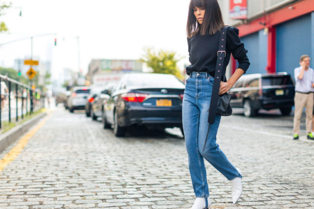 mom-jeans-ruffled-top-white-boots-nyfw-street-style-fall-outfits-hbz