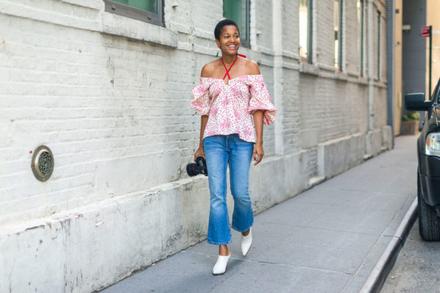 off-the-shoulder-top-cropped-flares-ruffle-sleeves-white-mules-booties-nyfw-street-style-fall-outfits-hbz-going-out-night-out