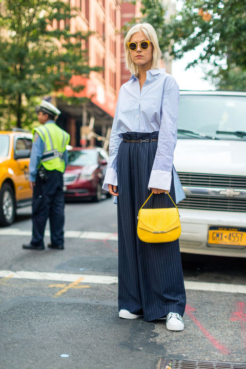 pinstripe-pants-wide-leg-pants-pinstripes-yellow-bag-sneakers-oversized-cuffs-fall-work-outfit-nyfw-street-style-fall-fashion-hbz
