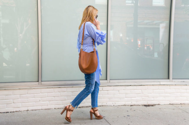 platform-sandals-saddle-bag-frayed-denim-ruffles-ruffled-off-the-shoulder-wrap-blouse-nyfw-street-style-hbz