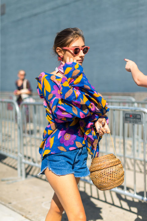 straw-bag-summer-to-fall-transitional-dressing-ruffle-sleeves-cutoffs-nyfw-street-style-fall-outfits-hbz-cutoffs-in-fall