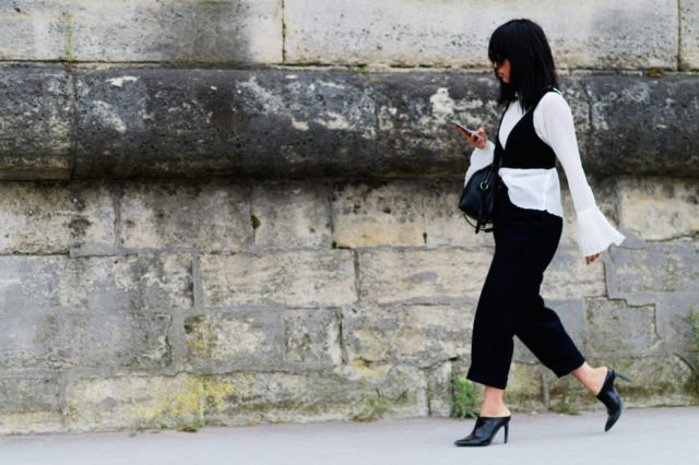 paris fashion week street style ss 2017, bra over shirt, corset, mules, black and white, bell sleeves, fall work outfit, cropped black pants